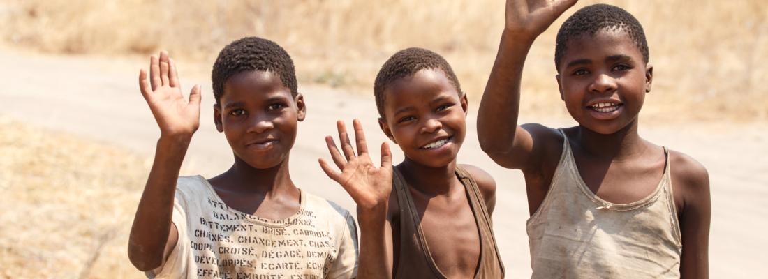 three young men waving